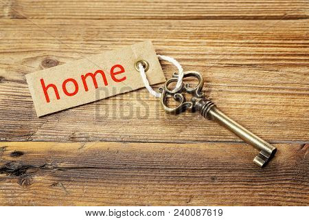 Antique Key With Tag On Weathered Wood, Home Concept