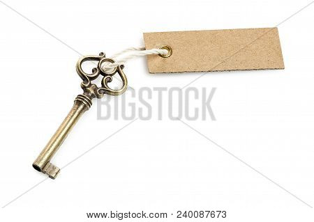 Antique Key With Tag Isolated On White