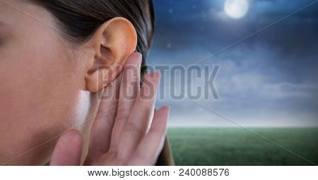 Woman listening to nature at night