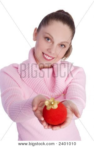 Young Girl Holding Christmas Ball