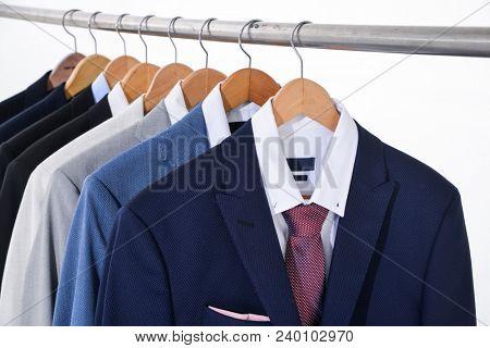 Set of men's row of suits hanger