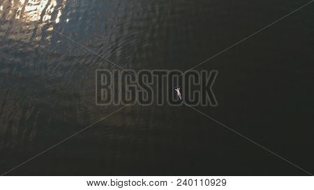 Young Girl Floats On An Inflatable Mattress In The Lake.aerial View:girl Is Happy And Float On Infla