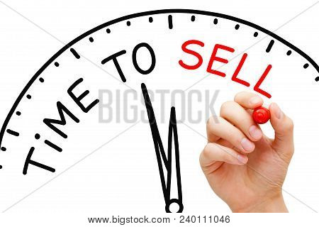 Hand Writing Time To Sell Concept With Red Marker On Transparent Wipe Board.