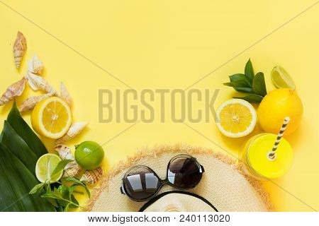 Straw Foman's Hat, Sun Glasses And Beach Accessory With Detox Citrics Water On Yellow. Top View. Fla