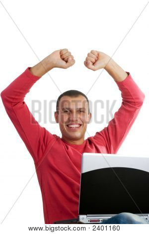 Happy Young Man Sitting With Laptop