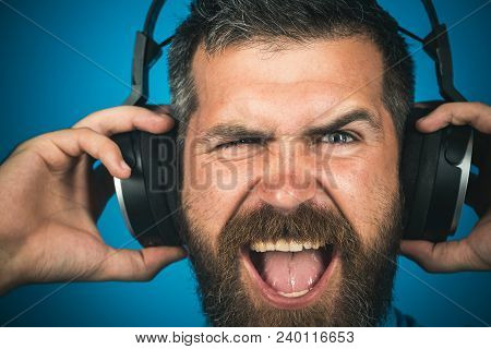 Emotional Man With Headphones Listening Music. Closeup Portrait. Stylish Happy Man Listening To Musi