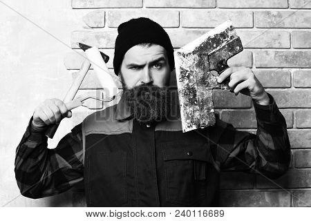 Bearded Builder Man, Long Beard, Brutal Caucasian Hipster With Moustache In Uniform Holding Various