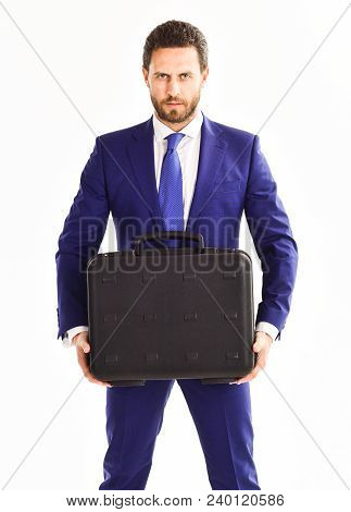 Businessman With Beard Delivers Briefcase. Man In Suit Or Businessman With Serious Face Holds Briefc