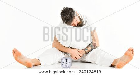 Man With Tattoo Fall Asleep While Sitting, White Background. Morning Alarm Concept. Hipster With Bea