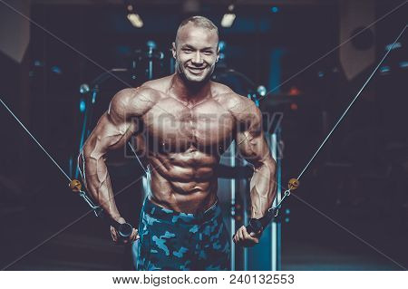 Handsome Model Young Man Training Chest In Gym