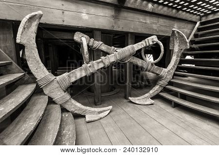 Genoa, Italy - May 14, 2017: Two Old Anchors In The Interior Of The Galleon Neptun Old Wooden Ship I