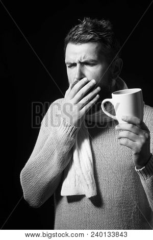 Healthcare, Treatment And Medicine Concept - Ill Man With Flu Coughing And Drinking Hot Tea From Cup
