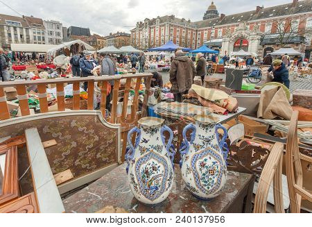 Brussels, Belgium - Apr 3: Flea Market With Old Ceramic Vases, Bargains And Antique Stuff In Boxes O