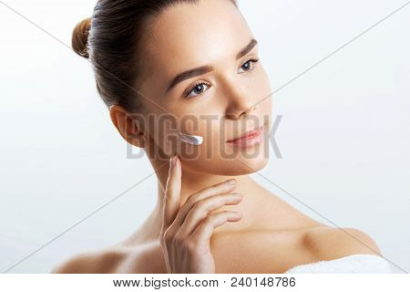 Closeup Portrait Of Beautiful Happy Girl With Nude Makeup And Natural Manicure Nails Applying Cosmet