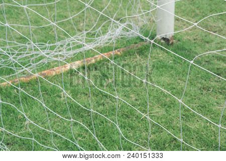 Net Of Soccer Goal On Grass Field., Empty Football Goal With White Net With Copy Space For Text., Sp