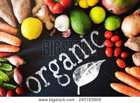 Top View Closeup Shot Of Fresh Organic Vegetables And Fruits On Slate Background With Word Organic,