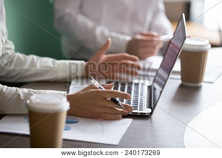 Businesswoman Using Laptop Presenting Project Statistics Report Or Market Analysis At Meeting, Makin
