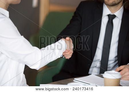 Businessman Handshaking Businesswoman Showing Respect, Female And Male Hands Shaking As Concept Of G