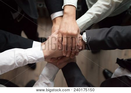 Motivated Business People Put Hands Together, Sales Team Engaging In Teambuilding Activity Promising