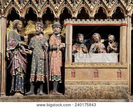 PARIS, FRANCE - JANUARY 04, 2018: Intricately carved and painted frieze inside Notre Dame Cathedral depicting Appearance to the disciples at Emmaus, UNESCO World Heritage Site in Paris, France.