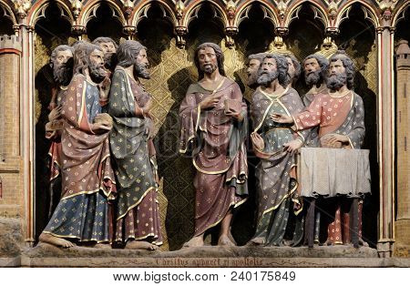 PARIS, FRANCE - JANUARY 04, 2018: Intricately carved and painted frieze inside Notre Dame Cathedral depicting Appearance to the Apostles in the Upper Room, UNESCO World Heritage Site in Paris, France.