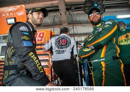 May 04, 2018 - Dover, Delaware, USA: Daniel Suarez (19) and Darrell Wallace, Jr (43) get ready to practice for the AAA 400 Drive for Autism at Dover International Speedway in Dover, Delaware.