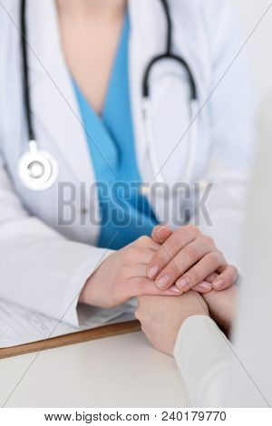 Medicine Doctor Hand Reassuring Her Female Patient Closeup. Medicine, Comforting  And Trusting Conce