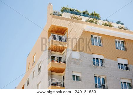 Residential Building With Balconies In Lisbon In Portugal. European Housing.