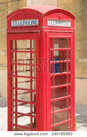 Classic British Style Of Red, Wooden Telephone-box With Blue Phone Inside