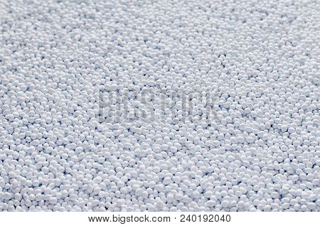 Polymer Additive In Granules Background Texture Close-up