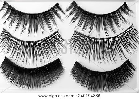 Different Types Of False Eyelashes On Light Background, Top View