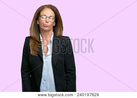 Middle age business woman making funny face fooling