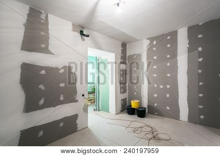 Metal Frames And Plasterboard -drywall- For Gypsum Walls, Three Buckets And Electric Wires  In Apart