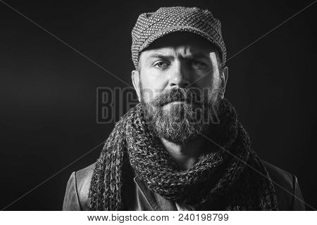 Autumn-winter Fashion. Stylish Man Wrapped In Scarf, Cap On Head, And Leather Jacket. Bearded Man Wi