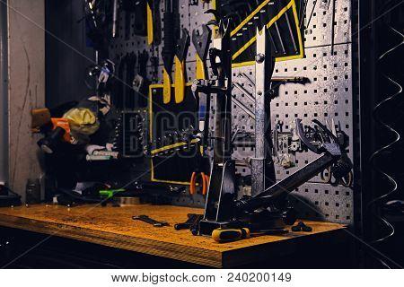 Bicycle Tools Stand In A Workshop. Bicycle Workshop