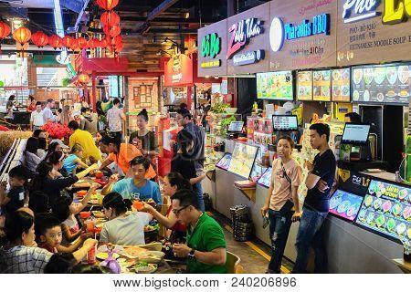 Ho Chi Minh City, Vietnam - April 29, 2018 :  People Eating At  Food Court, Asiana Fodd Town, Sense