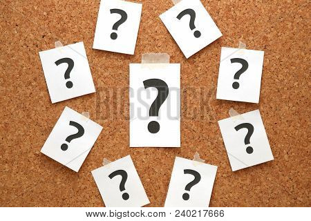 Question Mark On A Piece Of Paper And Many Question Marks On Cork Board. Question Concept.