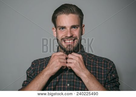 Smiling Handsome Bearded Man, Brutal Caucasian Hipster Which Fastens Top Button Checkered Shirt On N