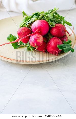 Bundle Of Fresh Ripe Radishes In A Plate. White Background. Rustic Style.