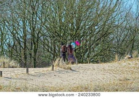Two Young Women With Helium Ballons Making A Selfie On A Sandy Dune. Nature Reserve Boberger Niederu