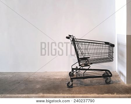 Black Shopping Cart Parked At The Supermarket