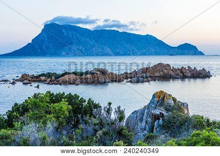 Sunrise Behind Isola Tavolara, North East Coast Of Sardinia