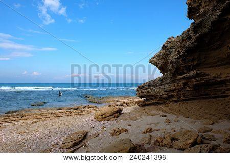 Alone Fisherman On Palmachim Beach, Mediterranean Seaside In Israel.