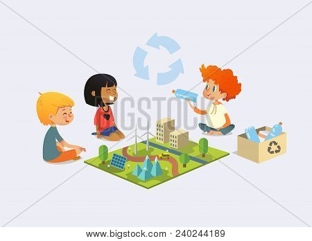 Happy Kids Sit On Floor In Circle Around Toy Model With Wind And Solar Power Plants, Redhead Boy Dem