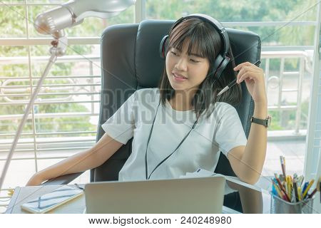 Student Learning Online Study Concept: Beautiful Asian Girl Sitting Smile Seem So Happy To Listening