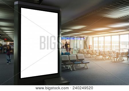 Mock Up Of Vertical Blank Advertising Billboard Or Light Box Showcase With Waiting Cone At Airport,