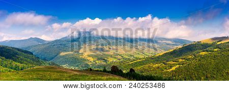 Panorama Of Mountainous Rural Area In Autumn. Lovely Countryside Scenery With Fluffy Clouds Above Th