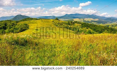 Autumnal Countryside Of Carpathian Mountains. Grassy Meadow And Magnificent Pikui Peak Of Carpathian