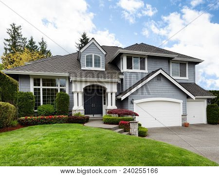 Clean Home With Healthy Front Yard During Late Spring Season