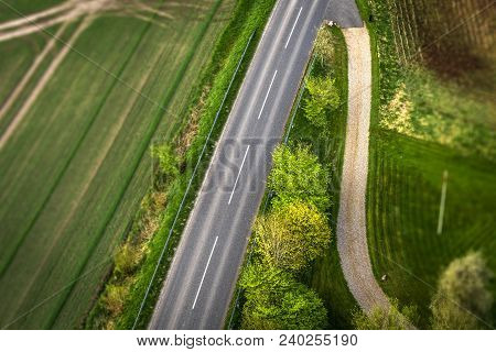 Highway Asphalt Road Seen From Above With Trees And Meadows Along The Roadside